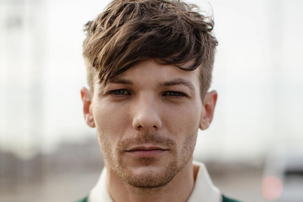 "Louis Tomlinson ""really wants to"" come to India, is ""gonna make it happen'!"