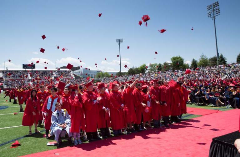 Graduates throw caps at Stony Brook University commencement ceremony LaValle Stadium May 22, 2015