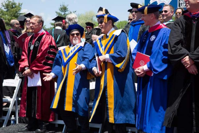 Samuel L. Stanley Jr., M.D., Billy Joel, Charles B. Wang, Cary Staller at Stony Brook University commencement ceremony May 22, 2015