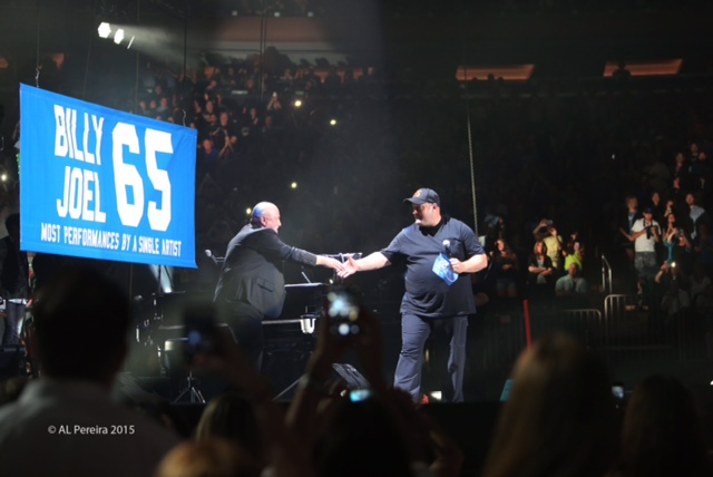 Billy Joel and Kevin James celebrate raising of new 65 banner at Madison Square Garden on July 1, 2015