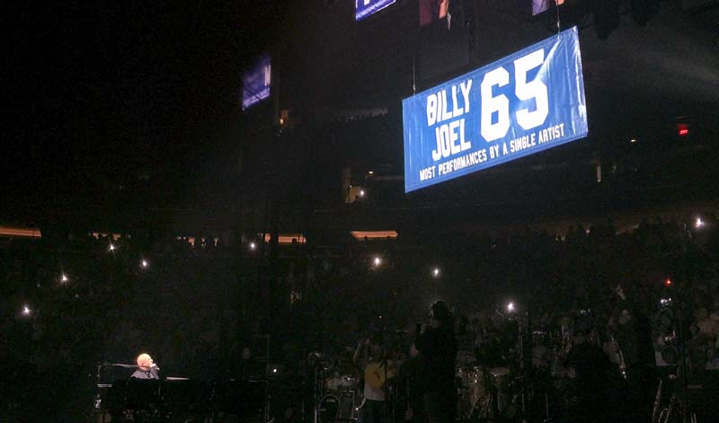 Billy Joel watches new 65 banner raised at Madison Square Garden in New York, NY, on July 1, 2015