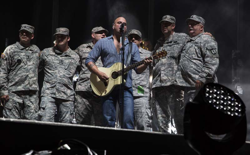 Mike DelGuidice with service men during Goodnight Saigon at M&T Bank Stadium in Baltimore, MD, on July 25, 2015