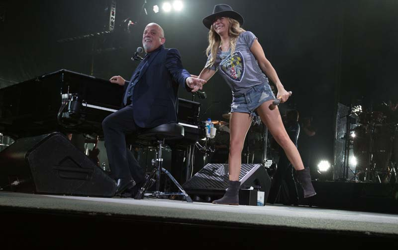 Leann Rimes performs You May Be Right with Billy Joel at M&T Bank Stadium in Baltimore, MD, on July 25, 2015