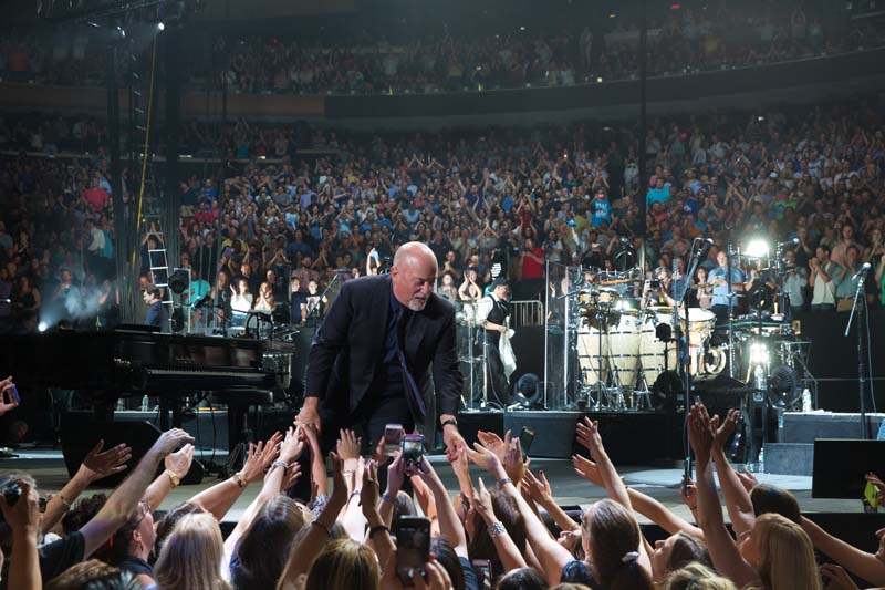 Billy Joel greets audience at 65th show at Madison Square Garden in New York, NY, on July 1, 2015