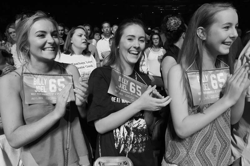 Fans wear banners to celebrate Billy Joel's 65th show at Madison Square Garden in New York, NY, on July 1, 2015