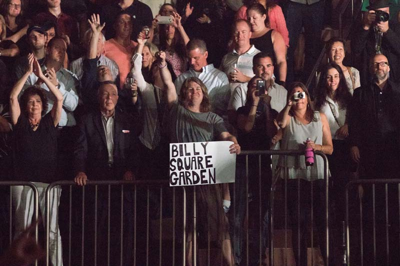 A fan holds Billy Square Garden sign during Billy Joel 65th show at Madison Square Garden in New York, NY, on July 1, 2015
