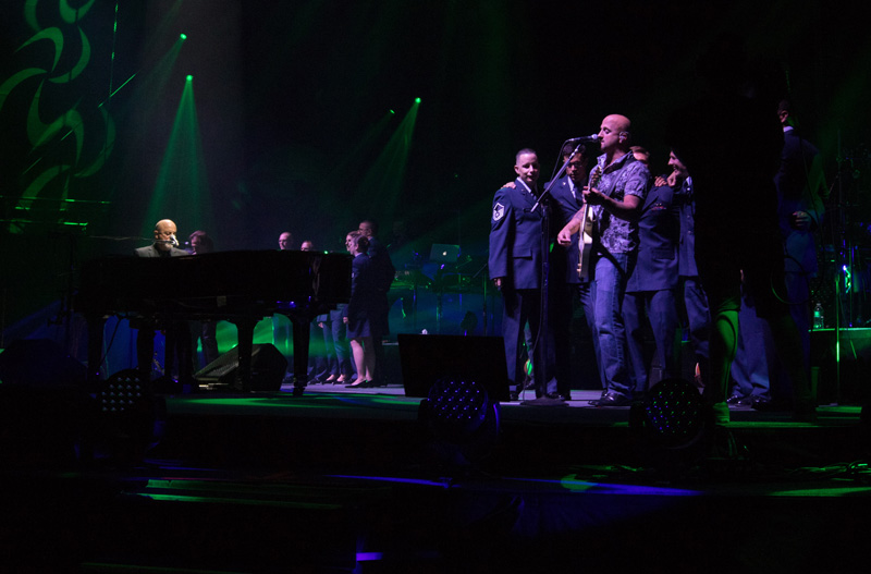 Members of U.S. Armed Forces join Billy Joel on stage for Goodnight Saigon at Fenway Park in Boston, MA, on July 16, 2015