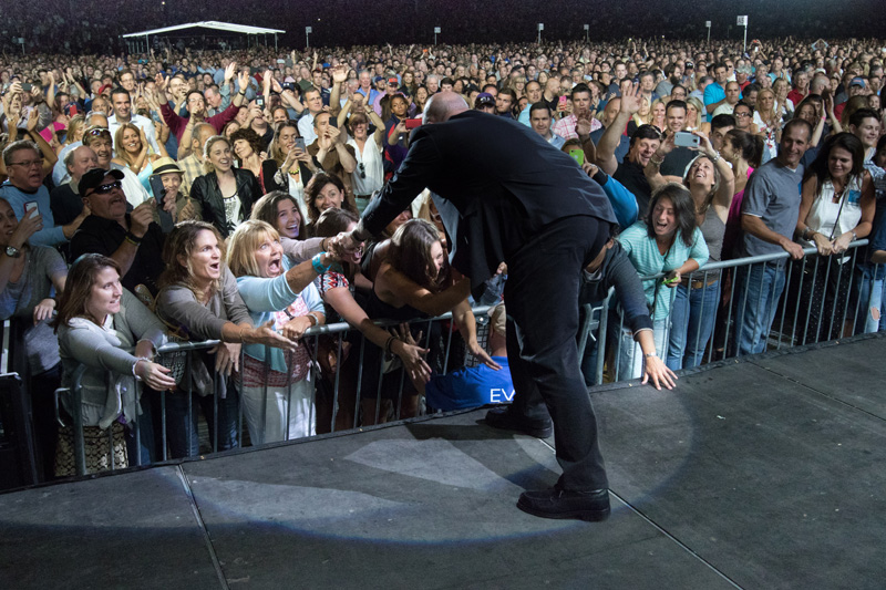 Billy Joel greets fans during Fenway Park concert in Boston, MA, on July 16, 2015