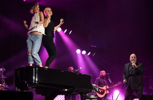 Watch: Amy Schumer & Jennifer Lawrence Dance On Billy Joel's Piano