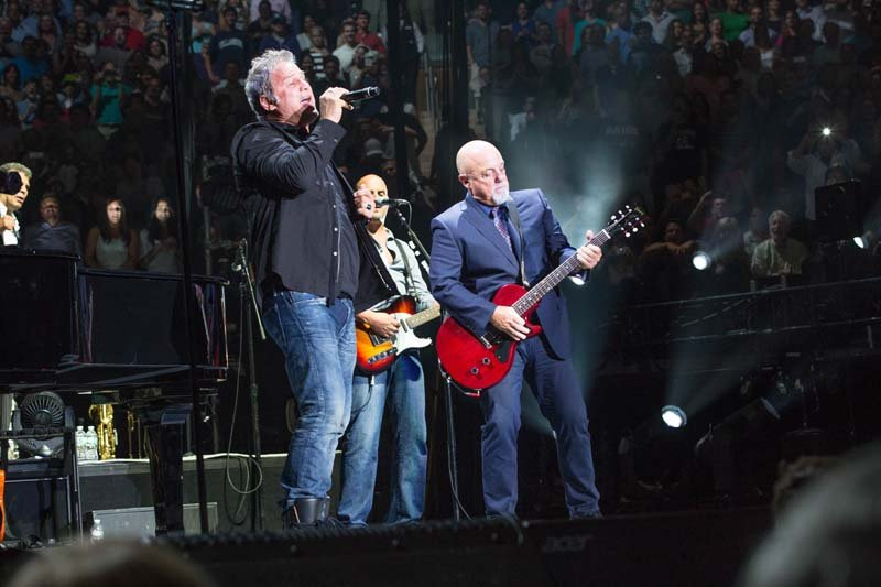 Jon Stevens and Billy Joel at Madison Square Garden on August 7, 2014