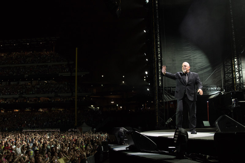 Billy Joel waves to the crowd on stage at Citizens Bank Park in Philadelphia, PA on July 9, 2016.