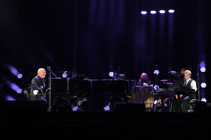 Billy Joel and Bradley Bartlett-Roche live on stage at Fenway Park in Boston, MA, on August 18, 2016.