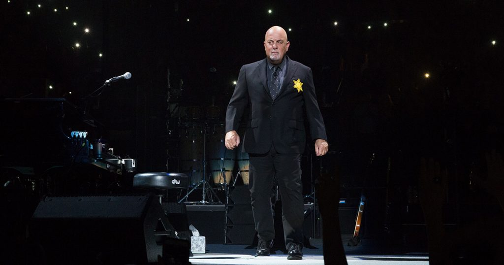 Billy Joel enters stage to perform his encores wearing Jewish Star of David at Madison Square Garden in New York, NY, on August 21, 2017