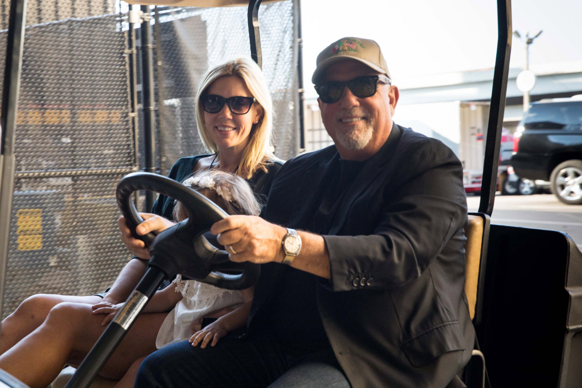 Billy Joel, Alexis Joel, Della Rose Joel ride golf cart to tour Target Field in Minneapolis, MN on July 28, 2017