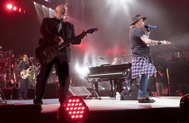 Billy Joel performs live on stage with Axl Rose at Target Field in Minneapolis, MN on July 28, 2017