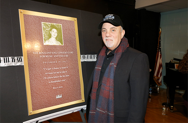 Billy Joel attends a dedication ceremony for the Rosalind Joel Conservatory for Music and Theatre at the Long Island High School for the Arts on December 19, 2017.