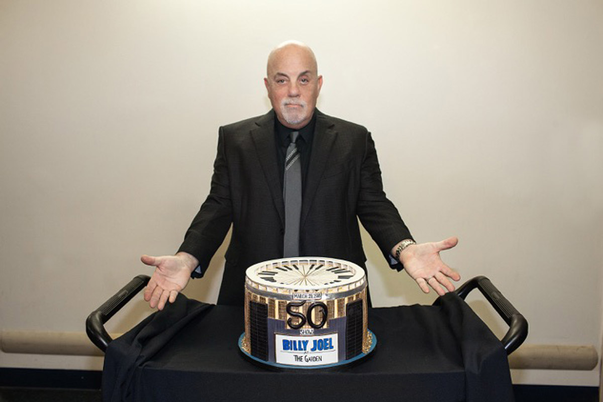 Billy Joel backstage at Madison Square Garden in New York, NY, on March 28, 2018 with a cake to celebrate the 50th consecutive show of his MSG residency