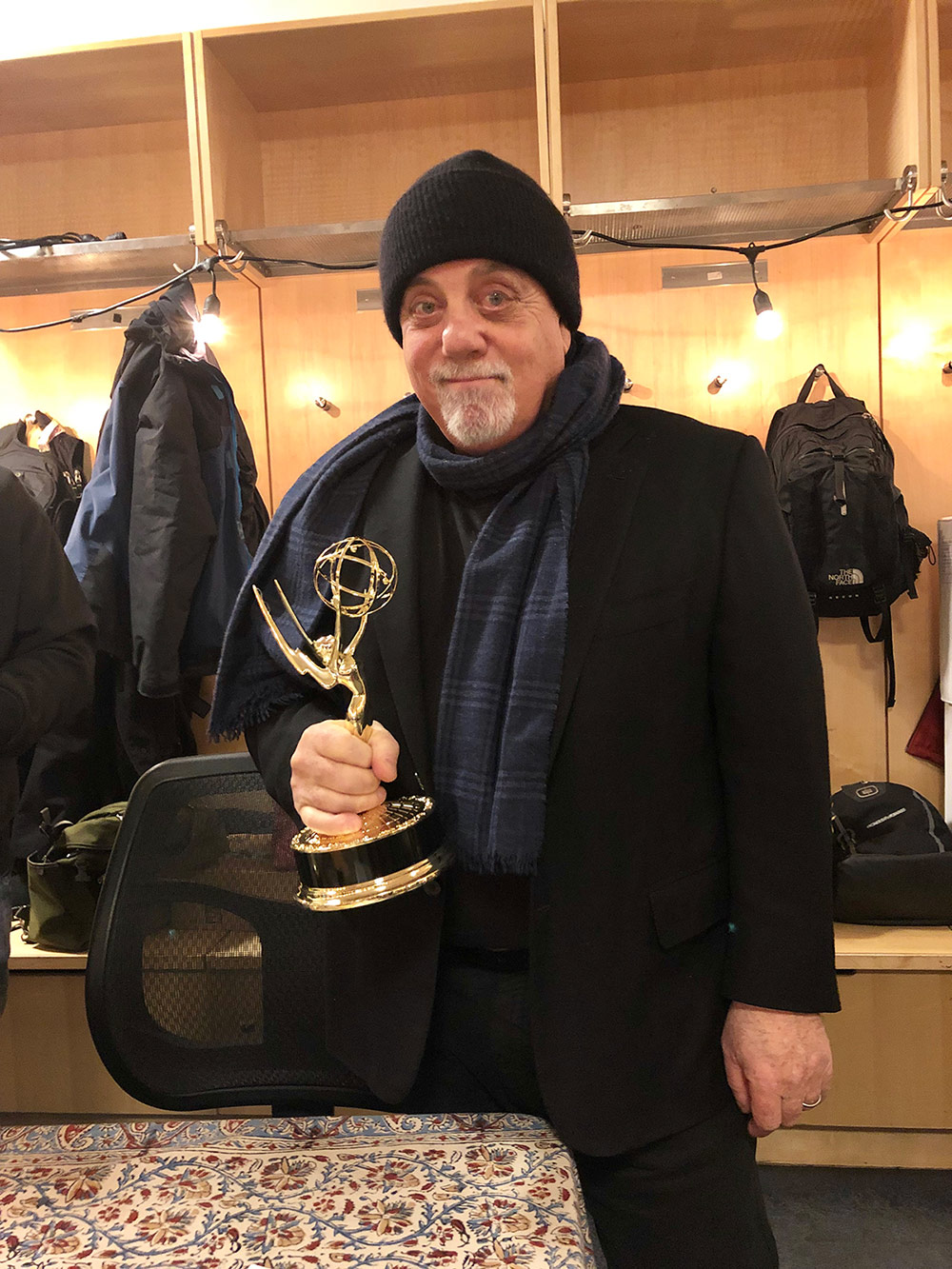 Billy Joel holds New York Emmy Award for the MSG Network documentary Billy Joel: New York State Of Mind