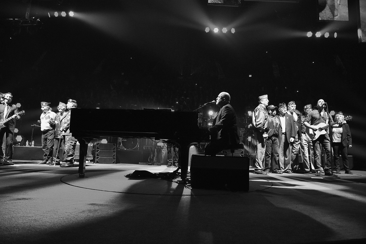 Billy Joel performs onstage with veterans during Goodnight Saigon at the newly renovated Nassau Coliseum, Long Island on April 5, 2017 in New York City. (Photo by Kevin Mazur/Getty Images)