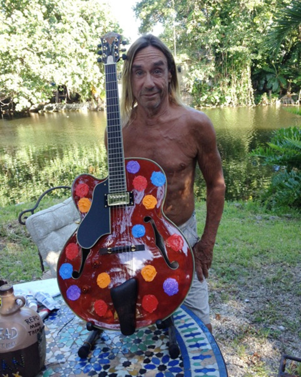 Iggy Pop with guitar for War Child USA
