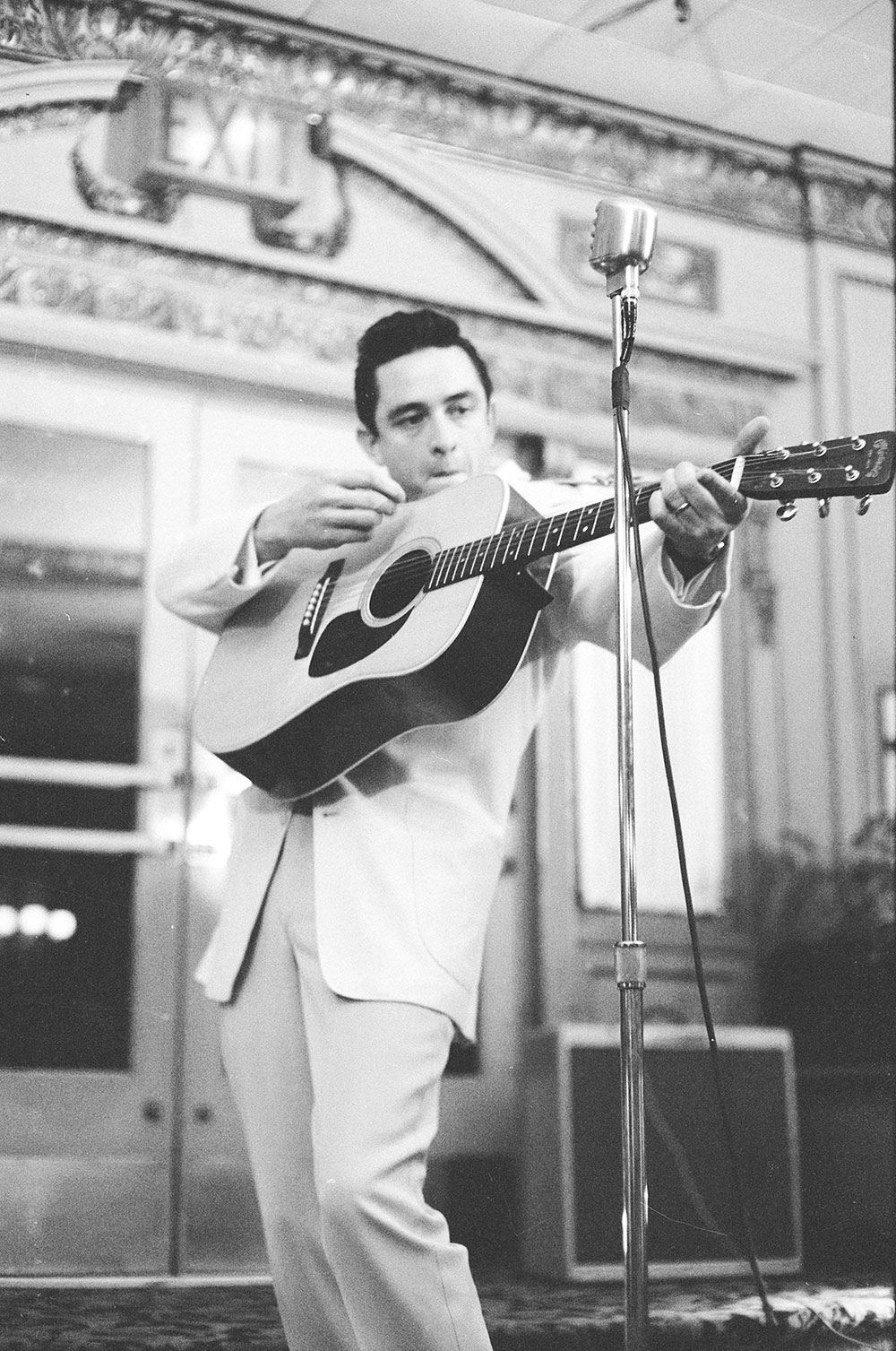 Johnny Cash performs at a press party in February 1959