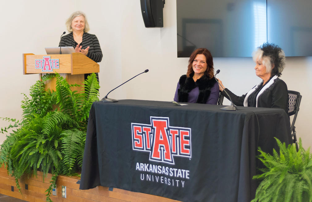 Rosanne Cash and Joanne Cash Yates at table during press conference for Johnny Cash Heritage Festival, with Dr. Ruth Hawkins, director of Arkansas State University Heritage Sites