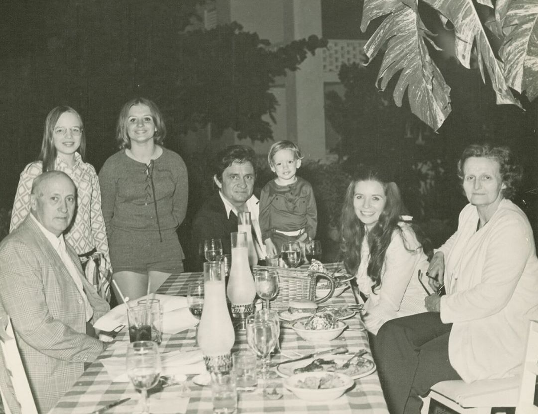 Johnny Cash, June Carter Cash, John Carter Cash and family gathered at table