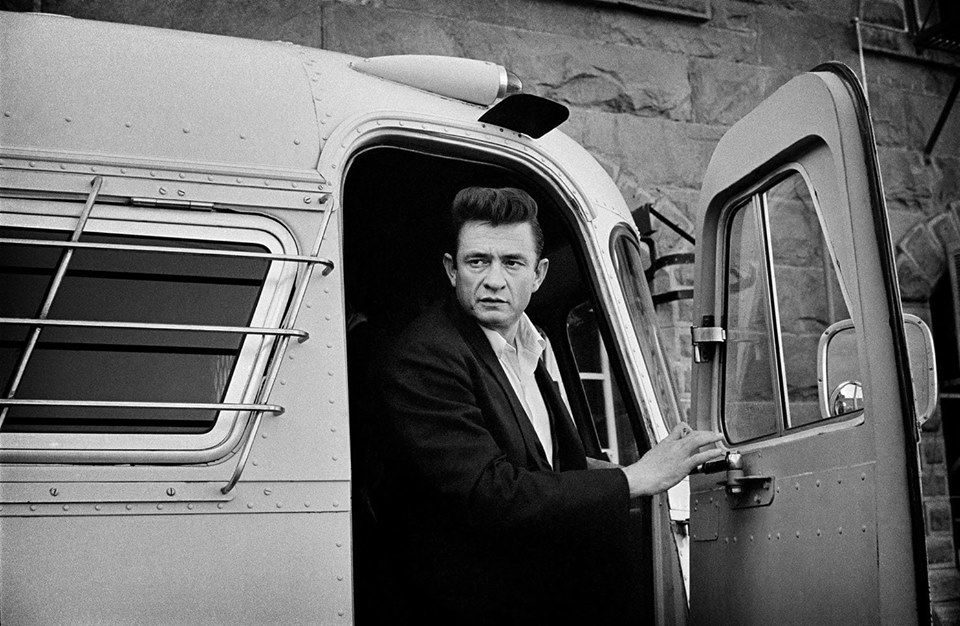 Johnny Cash arriving by bus at Folsom Prison for historic 1968 concert. Photo by Jim Marshall featured in book Johnny Cash at Folsom & San Quentin.