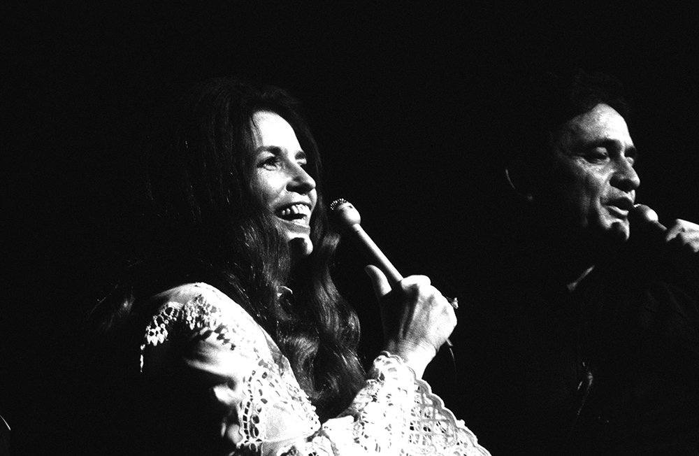 June Carter Cash and Johnny Cash perform live on stage in 1970