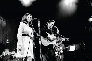 June Carter Cash and Johnny Cash perform live on stage
