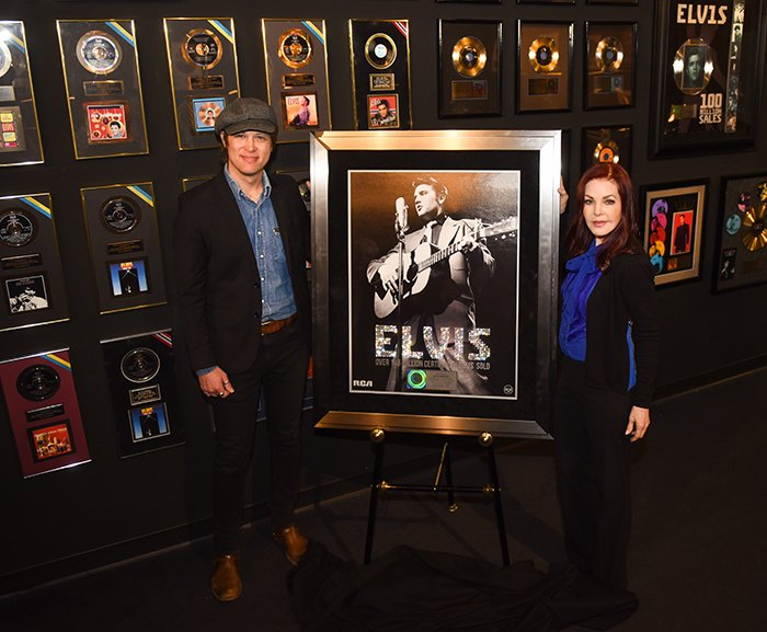 John Jackson, SVP of A&R for Legacy Recordings, presents Priscilla Presley and the Elvis Presley estate with a plaque from the RIAA commemorating over 146.5 million certified sales awards
