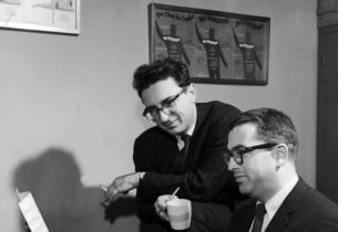 The composer and lyricist at work: Sheldon Harnick (standing) and Jerry Bock (se