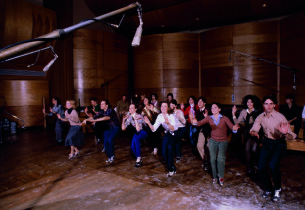 The cast rehearsing the title tune