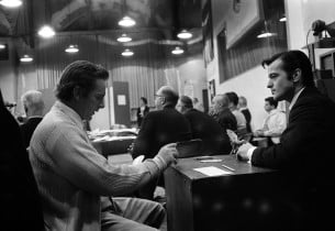 Richard Burton and Robert Goulet enjoying a card game during a break