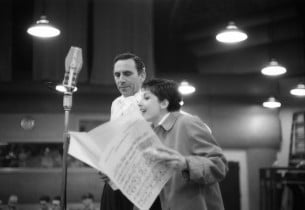 Zizi Jeanmaire and Goddard Lieberson going over a cue