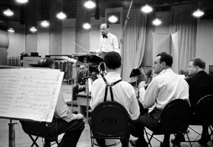 music director Max Goberman conducting the orchestra