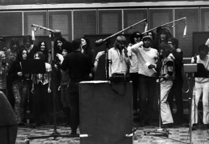 The cast in the recording studio