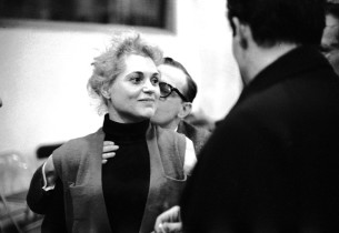 Judy Holliday receives a kiss from Jule Styne