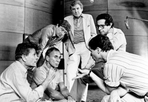 A control room conference, from l. to r. (front row): Jerry Herman, Arthur Laure