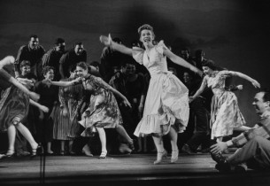 "Susan Johnson leads the cast in the spirited ""Big D"" number"