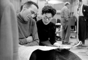 Goddard Lieberson and Eileen Rodgers studying the score (Photo: Guy Gillette)