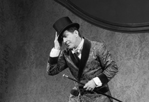 Robert Preston (with top hat and cane)