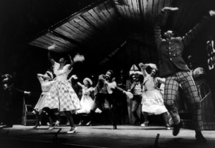 The cast in the production number,