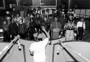 the cast in the recording studio with Hugh Masekela in the forefront