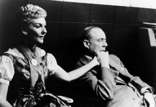 Mary Martin and composer Richard Rodgers listening to a playback in the control