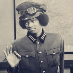 Michael Jackson wearing a pilot suit