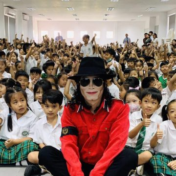 China's Michael Jackson impersonator visiting children in Laos spreading MJ's spirit and love for kids