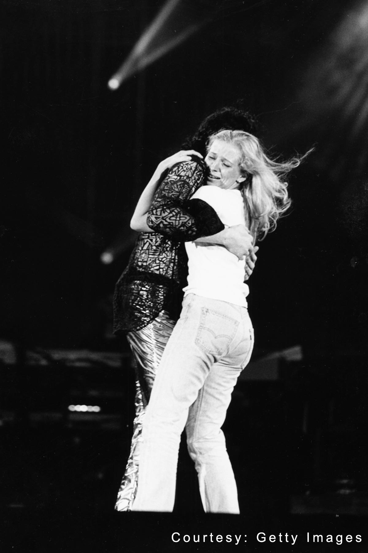 Michael Jackson hugs a fan on stage