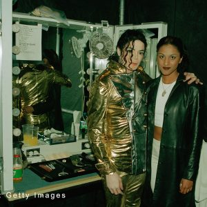 Michael Jackson and a fan backstage in Bremen, Germany, during HIStory World Tour 1997