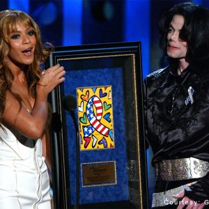 Beyoncé presenting the humanitarian award to Michael at the 2003 Radio Music Awards